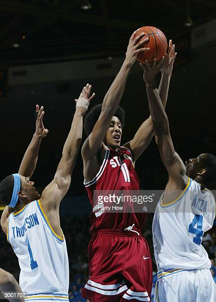 Josh Childress of Stanford wins a rebound of of Trevor Ariza and Dijon Thompson of UCLA in the first half during the game at Pauley Pavillion on...