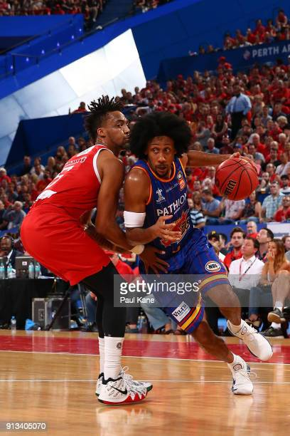 Josh Childress of the 36ers drives past Jean-Pierre Tokoto of the Wildcats during the round 17 NBL match between the Perth Wildcats and the Adelaide...