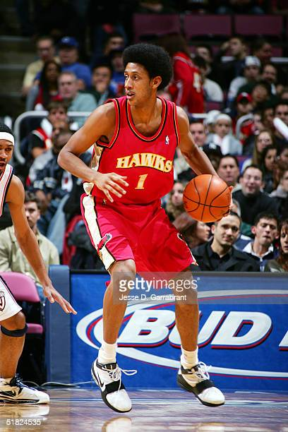 Josh Childress of the Atlanta Hawks looks for the pass against the New Jersey Nets on December 4, 2004 at the Continental Airlines Arena in East...