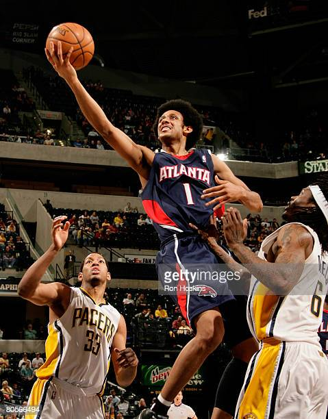 Josh Childress of the Atlanta Hawks shoots over Danny Granger and Marquis Daniels of the Indiana Pacers at Conseco Fieldhouse on April 8 2008 in...