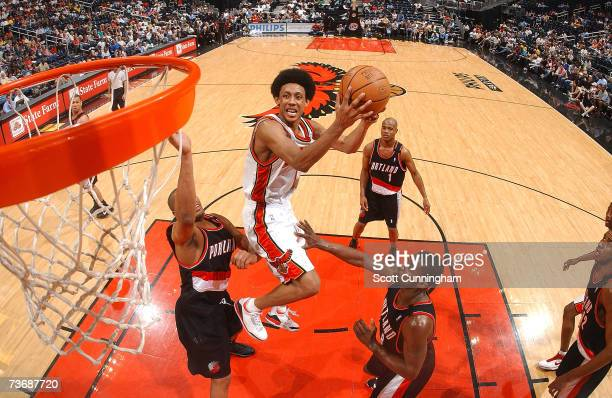 Josh Childress of the Atlanta Hawks splits two defenders and puts up a shot against the Portland Trail Blazers at Philips Arena on March 23 2007 in...