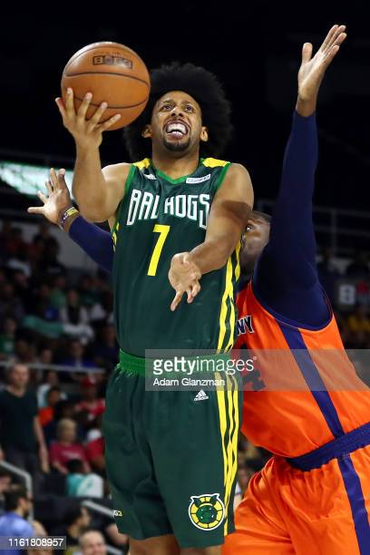 Josh Childress of the Ball Hogs drives to the basket against Jason Maxiell of 3's Company during week four of the BIG3 three on three basketball...