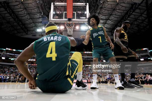 Josh Childress of the Ball Hogs helps Derrick Byars off the floor during the game against the Killer 3s during week six of the BIG3 three on three...