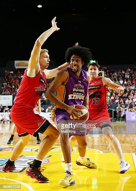 Josh Childress of the Kings drives to the basket under pressure from Shawn Redhage of the Wildcats during the round 11 NBL match between the Sydney...