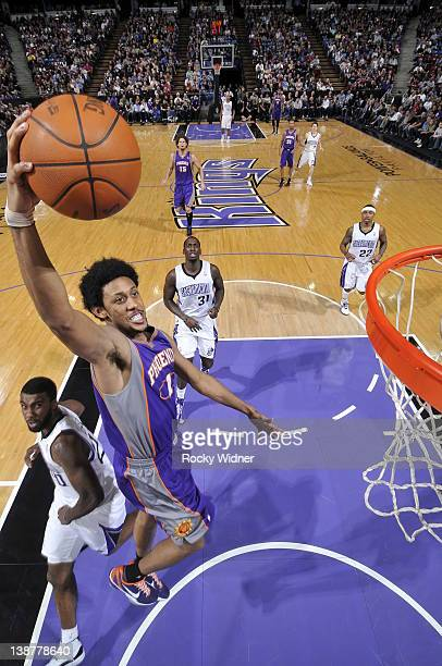 Josh Childress of the Phoenix Suns dunks the ball past Donte Greene of the Sacramento Kings on February 11, 2012 at Power Balance Pavilion in...
