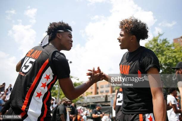 Josh Christopher of Team Zion high fives Jalen Green prior to the SLAM Summer Classic 2019 at Dyckman Park on August 18 2019 in New York City