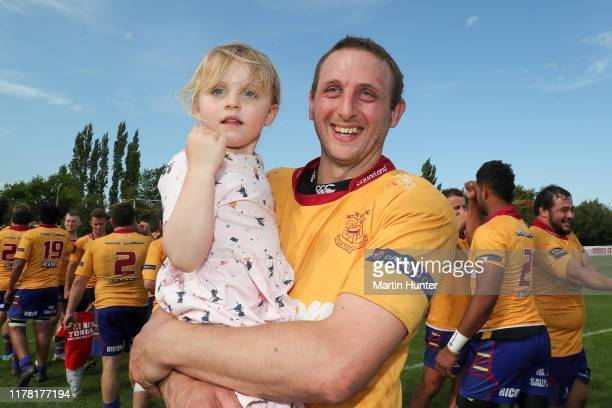 Josh Clark of North Otago celebrates with his daughter after the Mitre 10 Heartland Championship Meads Cup Final between North Otago and Wanganui at...