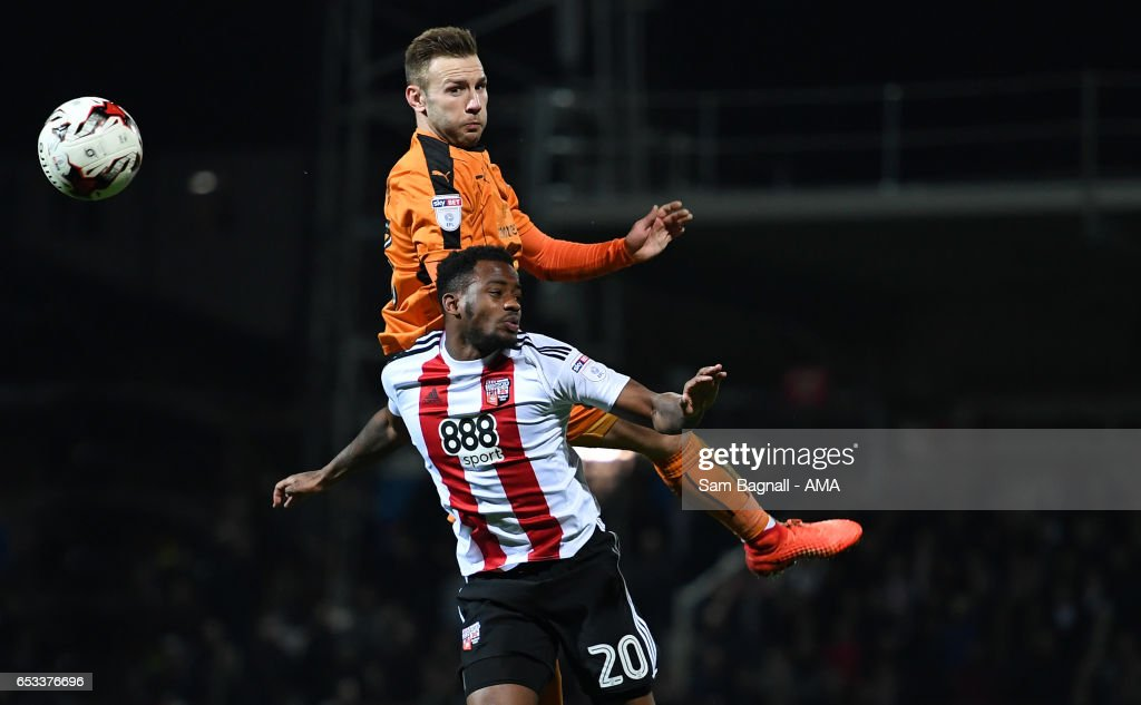 Josh Clarke of Brentford and Andy Weimann of Wolverhampton Wanderers during the Sky Bet Championship match between Brentford and Wolverhampton Wanderers at Griffin Park on March 14, 2017 in Brentford, England.