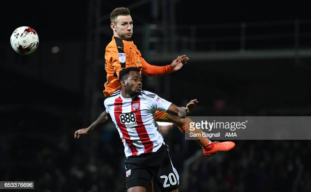 Josh Clarke of Brentford and Andy Weimann of Wolverhampton Wanderers during the Sky Bet Championship match between Brentford and Wolverhampton...