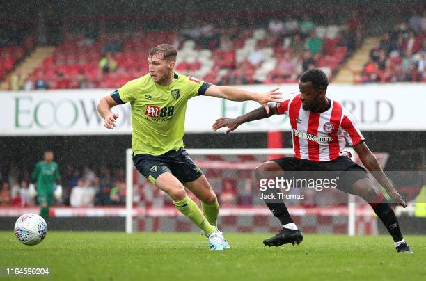 Josh Clarke of Brentford challenges for the ball with Jack Stacey of AFC Bournemouth during the Pre-Season Friendly match between Brentford and AFC...