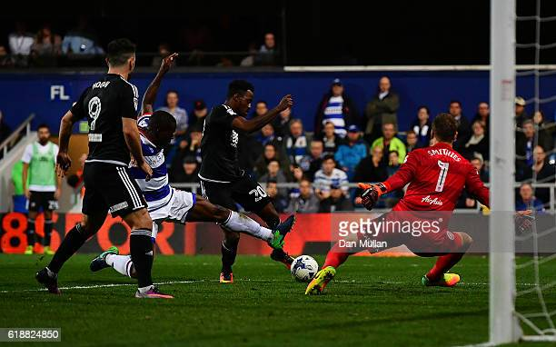 Josh Clarke of Brentford scores his side's first goal past Alex Smithies of Queens Park Rangers during the Sky Bet Championship match between Queens...