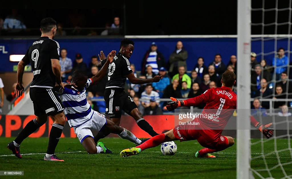 Josh Clarke of Brentford scores his side's first goal past Alex Smithies of Queens Park Rangers during the Sky Bet Championship match between Queens Park Rangers and Brentford at Loftus Road on October 28, 2016 in London, England.