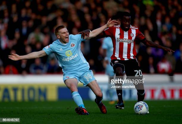 Josh Clarke of Brentford tackles with Duncan Watmore of Sunderland during the Sky Bet Championship match between Brentford and Sunderland at Griffin...