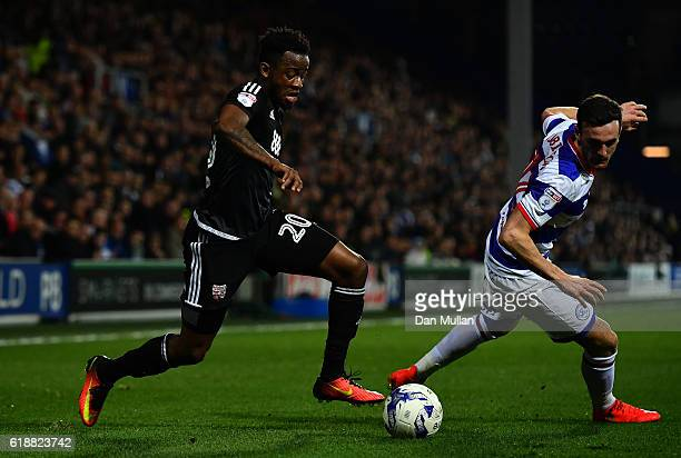 Josh Clarke of Brentford takes on Jack Robinson of Queens Park Rangers during the Sky Bet Championship match between Queens Park Rangers and...