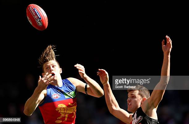Josh Clayton of the Lions competes for the ball during the round 23 AFL match between the St Kilda Saints and the Brisbane Lions at Etihad Stadium on...