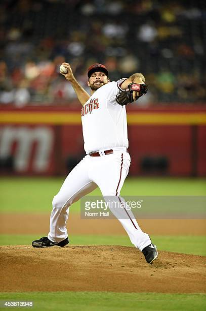 Josh Collmenter of the Arizona Diamondbacks delivers a pitch against the Pittsburgh Pirates at Chase Field on July 31 2014 in Phoenix Arizona