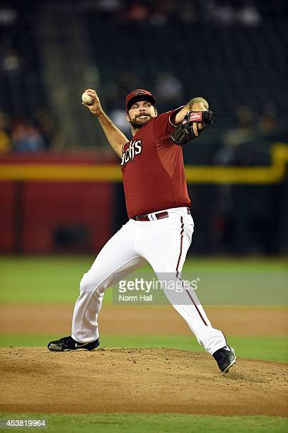 Josh Collmenter of the Arizona Diamondbacks delivers a pitch against the Kansas City Royals at Chase Field on August 6 2014 in Phoenix Arizona