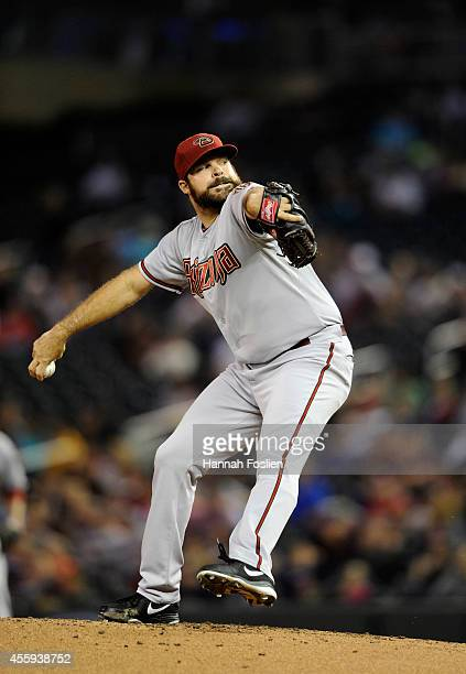 Josh Collmenter of the Arizona Diamondbacks delivers a pitch against the Minnesota Twins during the first inning of the game on September 22 2014 at...
