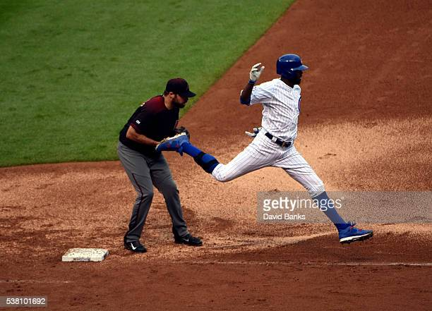 Josh Collmenter of the Arizona Diamondbacks forces out Dexter Fowler of the Chicago Cubs during the seventh inning on June 4 2016 at Wrigley Field in...