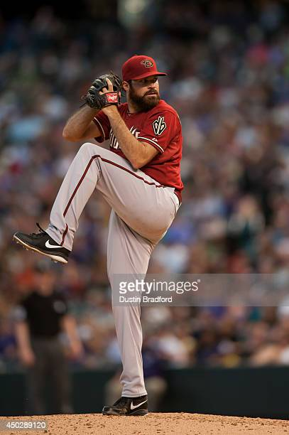 Josh Collmenter of the Arizona Diamondbacks pitches against the Colorado Rockies during a game at Coors Field on June 4 2014 in Denver Colorado The...