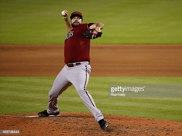Josh Collmenter of the Arizona Diamondbacks pitches during the fourth inning of the game against the Miami Marlins at Marlins Park on August 17 2014...