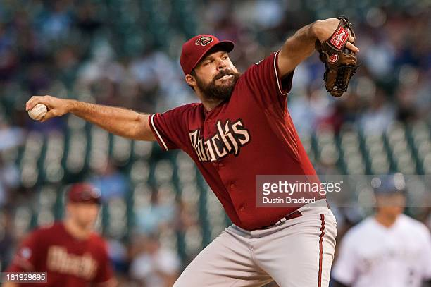 Josh Collmenter of the Arizona Diamondbacks pitches in relief in the ninth inning of a game against the Colorado Rockies at Coors Field on September...