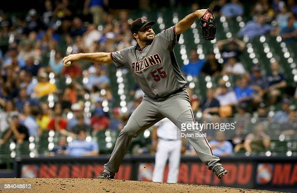 Josh Collmenter of the Arizona Diamondbacks pitches in the eighth inning against the Milwaukee Brewers at Miller Park on July 25 2016 in Milwaukee...