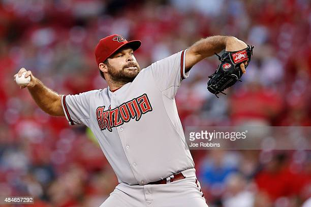 Josh Collmenter of the Arizona Diamondbacks pitches in the third inning against the Cincinnati Reds at Great American Ball Park on August 20 2015 in...