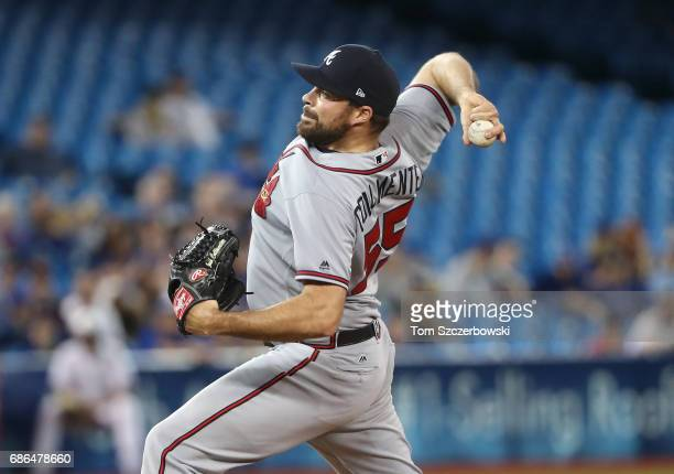 Josh Collmenter of the Atlanta Braves delivers a pitch in the ninth inning during MLB game action against the Toronto Blue Jays at Rogers Centre on...
