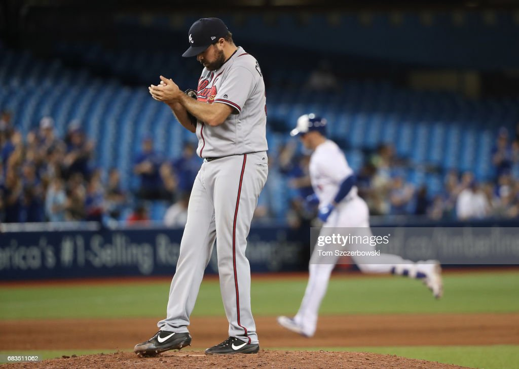Josh Collmenter #55 of the Atlanta Braves reacts after giving up a two-run home run in the ninth inning during MLB game action to Justin Smoak #14 of the Toronto Blue Jays at Rogers Centre on May 15, 2017 in Toronto, Canada.
