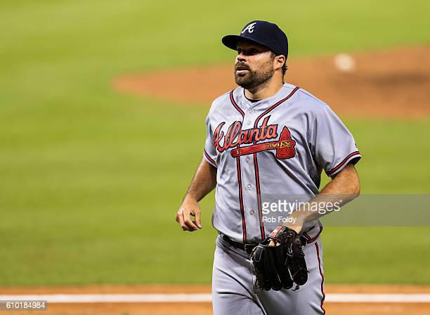 Josh Collmenter of the Atlanta Braves runs off the field during the game against the Miami Marlins at Marlins Park on September 22 2016 in Miami...