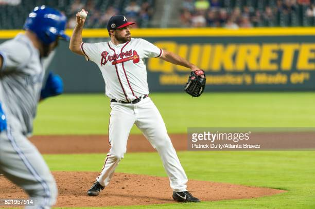 Josh Collmenter of the Atlanta Braves throws to first base against the Toronto Blue Jays at SunTrust Park on May 18 2017 in Atlanta Georgia The Blue...