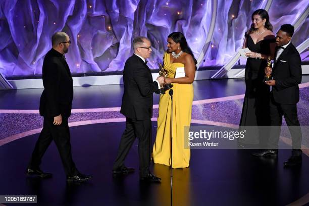 Josh Cooley and Mark Nielsen accept the Animated Feature Film award for 'Toy Story 4' from Mindy Kaling onstage during the 92nd Annual Academy Awards...
