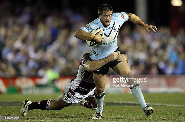Josh Cordoba of the Sharks is tackled during the round five NRL match between the Cronulla Sharks and the Manly Warringah Sea Eagles at Toyota...