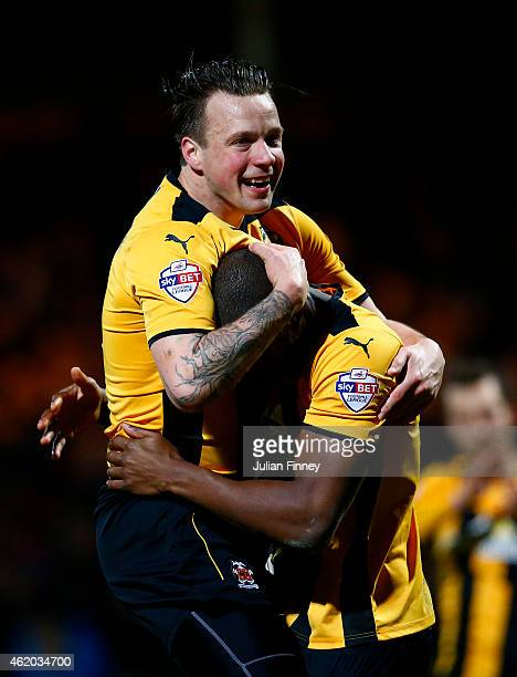 Josh Coulson of Cambridge United celebrates with team-mate Tom Elliott after the FA Cup Fourth Round match between Cambridge United and Manchester...