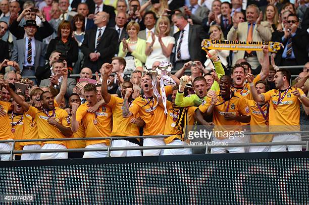 Josh Coulson of Cambridge United lifts the Trophey during the Skrill Conference Premier PlayOffs Final between Cambridge United and Gateshead FC at...