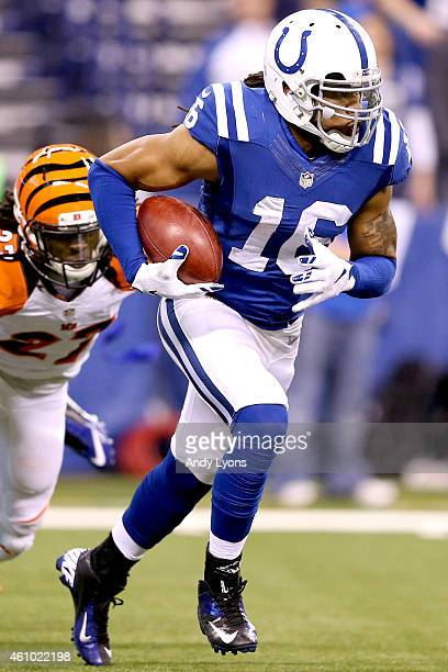 Josh Cribbs of the Indianapolis Colts returns a punt against the Cincinnati Bengals in the first half during their AFC Wild Card game at Lucas Oil...