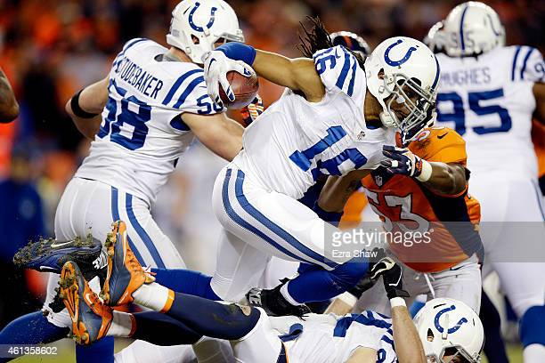 Josh Cribbs of the Indianapolis Colts runs through traffic on a kickoff return against the Denver Broncos during a 2015 AFC Divisional Playoff game...