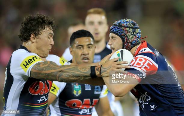 Josh Curran of the Roosters is tackled by James FisherHarris of the Panthers during the NRL trial match between the Penrith Panthers and the Sydney...