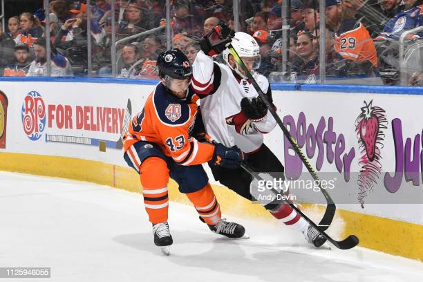 Josh Currie of the Edmonton Oilers battles for the puck against Jordan Oesterle of the Arizona Coyotes on February 19 2019 at Rogers Place in...