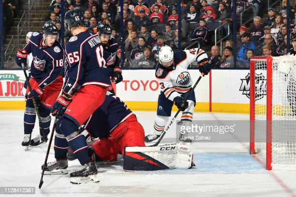 Josh Currie of the Edmonton Oilers redirects the puck into the net during the second period of a game against the Columbus Blue Jackets on March 2...