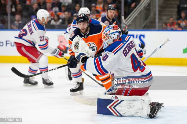 Josh Currie of the Edmonton Oilers takes a shot on goaltender Alexandar Georgiev of the New York Rangers during the second period at Rogers Place on...