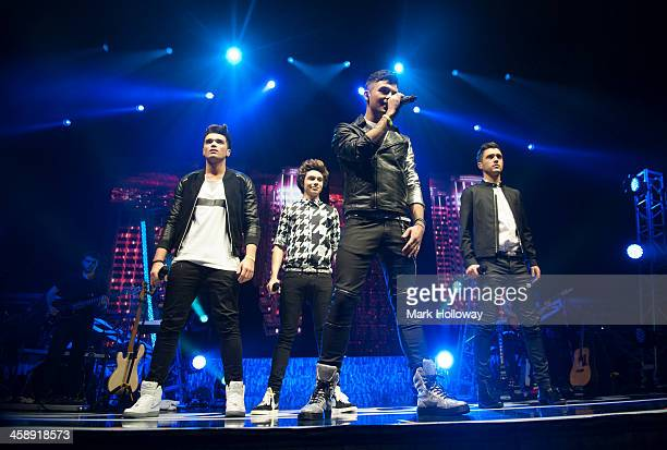 Josh Cuthbert George Shelley Jaymi Hensley and JJ Hamblett of Union J performs at BIC on December 22 2013 in Bournemouth England