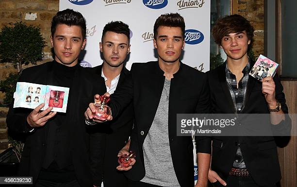 Josh Cuthbert JJ Hamblett Jaymi Hensley and George Shelley of Union J at the launch of their fragrance at The Sanctum Hotel on September 24 2014 in...