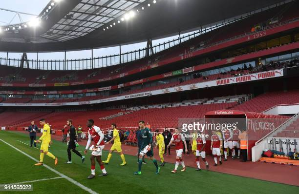 Josh Dasilva leads out the Arsenal team before the match between Arsenal U23 and Villarreal U23 at Emirates Stadium on April 10 2018 in London England