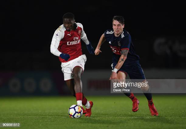 Josh Dasilva of Arsenal is challenged by Adrian Fein of Bayern during the Premier League International Cup Match between Arsenal and Bayern Munich at...