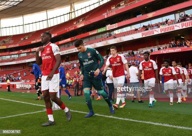 Josh Dasilva of Arsenal leads out the Arsenal team before the match between Arsenal and FC Porto at Emirates Stadium on May 8 2018 in London England