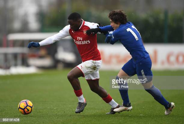 Josh Dasilva of Arsenal takes on Harvey St Clair of Chelsea during the match between Arsenal U23 and Chelsea U23 at London Colney on March 17 2018 in...