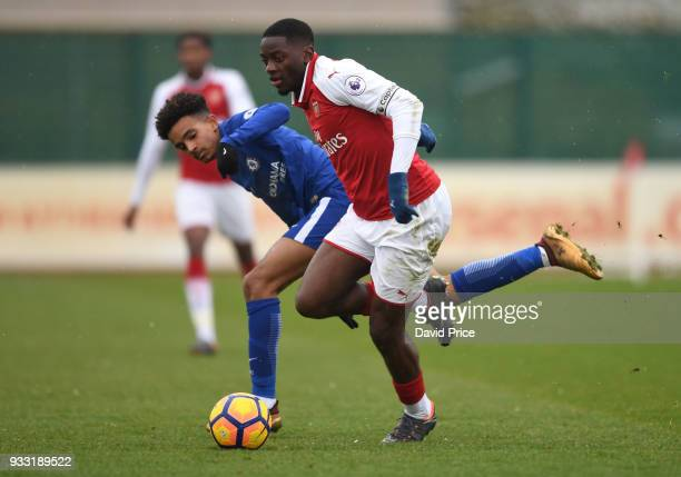 Josh Dasilva of Arsenal takes on Jacob Maddox of Chelsea during the match between Arsenal U23 and Chelsea U23 at London Colney on March 17 2018 in St...
