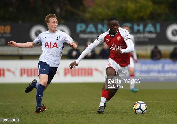 Josh Dasilva of Arsenal takes on Oliver Skipp of Tottenham during the match between Arsenal and Tottenham Hotspur at Meadow Park on March 10 2018 in...